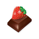 Chocolate piece with strawberry fruit on top Stock Image