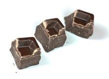 Chocolate pieces. Three chocolate pieces on white background Stock Photo