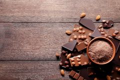 Chocolate pieces with cocoa powder royalty free stock photo