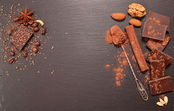 Chocolate pieces, cocoa powder, cinnamon, almonds, filbert, anis Royalty Free Stock Images