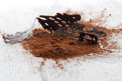 Chocolate pieces and cocoa powder on a wooden table Royalty Free Stock Photo