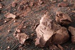Chocolate pieces on a dark backround. Handmade chocolate pieces on a dark wooden backround Royalty Free Stock Photography