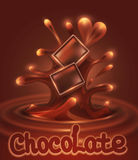 chocolate pieces falling into melted choc Royalty Free Stock Images