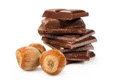 Chocolate pieces with hazelnuts close-up Stock Photography