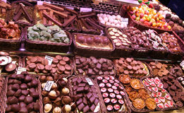Chocolate pieces on a market stall. Different kind of sweet chocolate and candy pieces on a market stall Royalty Free Stock Photos