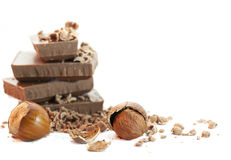 Chocolate pieces with nuts Royalty Free Stock Photos