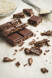 Chocolate pieces with sesame seeds. Stock Photography