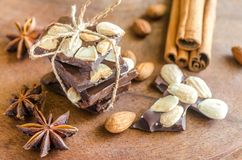 Chocolate pieces with spice, cinnamon and anise Royalty Free Stock Photos