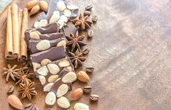 Chocolate pieces with spice, cinnamon and anise Royalty Free Stock Images