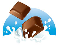 Chocolate pieces splashing in milk Royalty Free Stock Photo