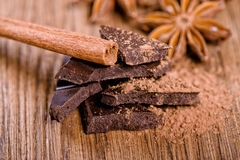 Chocolate pieces, star anise and cinnamon stick Royalty Free Stock Photo