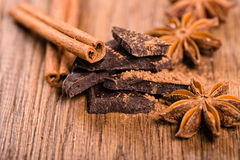 Chocolate pieces, star anise and cinnamon stick close up Royalty Free Stock Photo