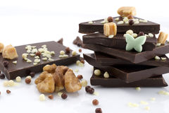 Chocolate. Pieces and walnut on white background Stock Photo
