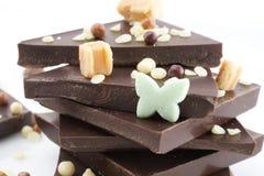 Chocolate. Pieces on white background Royalty Free Stock Photos