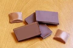 Chocolate pieces on wooden background. Selective focus Royalty Free Stock Images