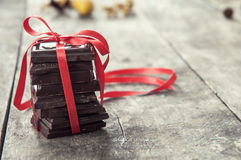 Chocolate pieces on wooden table Royalty Free Stock Photo