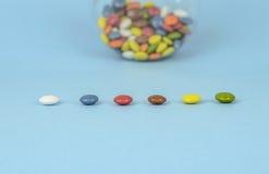 Chocolate pills Stock Photography