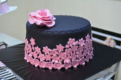 Chocolate in pink. Black and pink chocolate cake matching bridal shower theme Royalty Free Stock Photos
