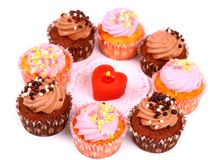 Chocolate and pink cup cakes with candle heart Royalty Free Stock Image
