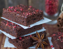 Chocolate and pink pepper brownie cakes. Stock Photo
