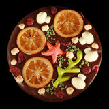 Chocolate pizza. A pizza made of chocolate, pralinés and candied fruit Royalty Free Stock Photography
