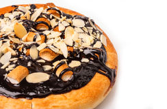 Chocolate pizza with almonds in isolated on black Stock Images