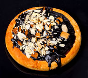 Chocolate pizza with almonds in isolated on black Royalty Free Stock Image
