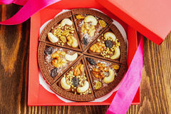 Chocolate pizza in gift box on wooden background Royalty Free Stock Photos