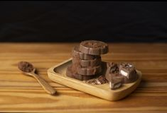 Chocolate placed in a wooden plate wooden floor wooden spoon stock image