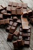 Chocolate plates on the grey wooden background Stock Image