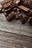 Chocolate plates on the grey wooden background Royalty Free Stock Image