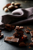 Chocolate plates tower on the black background Royalty Free Stock Images