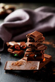 Chocolate plates tower on the black background Stock Images