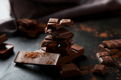 Chocolate plates tower on the black background Royalty Free Stock Photos