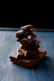 Chocolate plates tower on the blue wooden background Royalty Free Stock Images