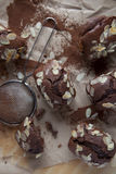 Chocolate plum cake with cacao powder and almond flakes Royalty Free Stock Images