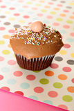 Chocolate polka dot cupcake. Shot of chocolate polka dot cupcake Stock Image