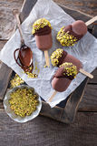 Chocolate pops with pistachios Stock Photo