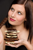 Chocolate - portrait healthy woman enjoy sweets. Chocolate - portrait of healthy woman enjoy sweets on black background Stock Image