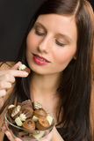 Chocolate - portrait young healthy woman eat candy Stock Photo