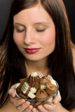 Chocolate - portrait young woman enjoy candy Stock Photos