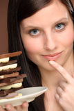 Chocolate - portrait young woman temptation Royalty Free Stock Images