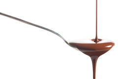 Chocolate poured into a spoon Stock Photos
