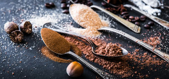 Chocolate powder cocoa and coffee spoons on the table Stock Photo