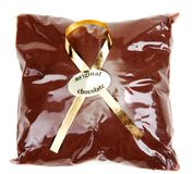 Chocolate powder in gift package and golden tape Royalty Free Stock Photography
