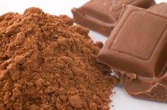 Chocolate powder and milk chocolate blocks royalty free stock image