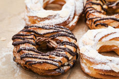 Chocolate and powdered sugar cream puff rings choux pastry Stock Photography