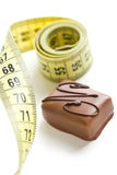 Chocolate praline with measuring tape Stock Photography