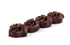 Chocolate pralines. Delicious chocolate pralines isolated on white background Royalty Free Stock Image