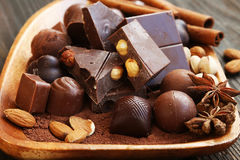 Chocolate pralines assortment with cocoa,almonds and anise Royalty Free Stock Images